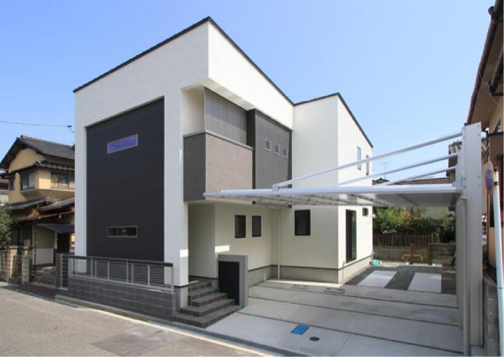 白・黒・茶色のカラーリングがお洒落なシンプルモダンの家
